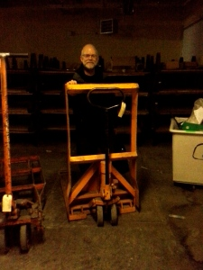 Me on 'my' Pallet jack. This was my friend and enemy. It saved my back but broke my foot! It sold for a couple hundred.